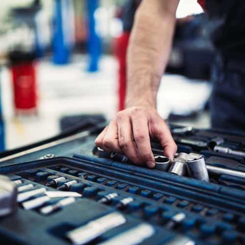 Mechanics hand on engine